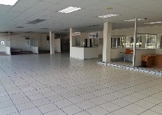 The subject property is situated on Josiah Gumede (Old Main) Road – Pinetown. The immediate area comprises of international automotive dealerships, retail and commercial type properties. A corner property, the subject offers double road frontage and a well balanced tenant mix. A two- storey building with access being gained off both Josiah Gumede and Mason Road – this includes drive up ramp access to the upper floors.